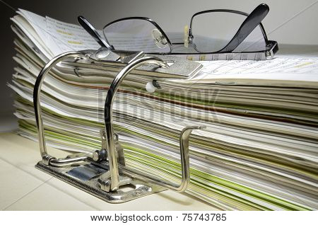 Folder In A Office And Glasses