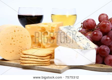 Types of cheese, wine, grapes, crackers