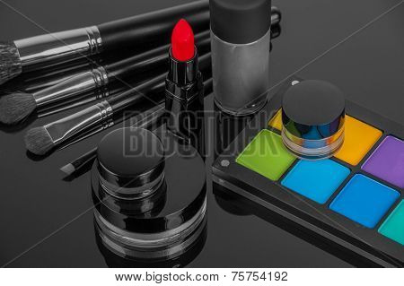 Set of professional makeup and cosmetics. on a black background isolated poster