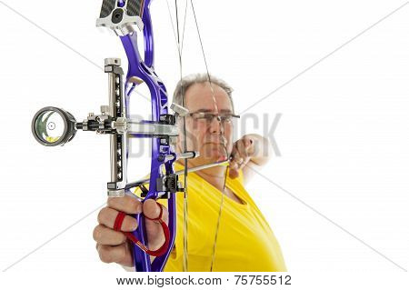 Man Shooting With Bow An Arrow In Close Up