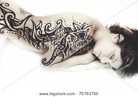 Tattoed, Latina with beautiful hand-painted tattoos on the skin