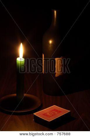 Wine, candle and playing cards