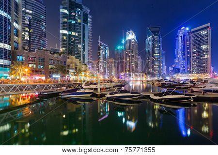 DUBAI, UAE - 31 MARCH 2014: Skyscrapers of Dubai Marina at night, UAE. Dubai Marina is a district in Dubai with artificial canal city who accommodates more than 120,000 people at Persian Gulf.