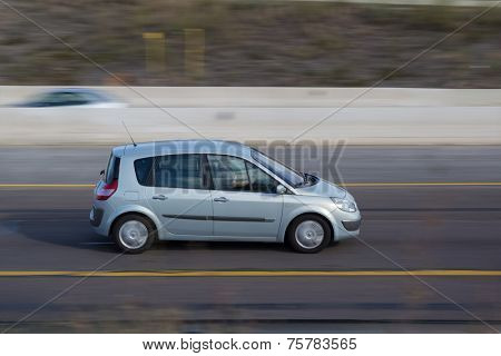 VALENCIA, SPAIN - NOVEMBER 7, 2014: A blue Renault Scenic auto on the highway in Valencia. The Scenic is a compact mult-purpose vehicle (MPV) produced by French automaker Renault.