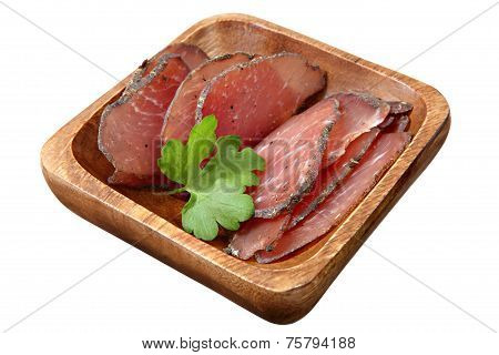 Dry-cured Pork Slices On Wooden Dish, Over White.