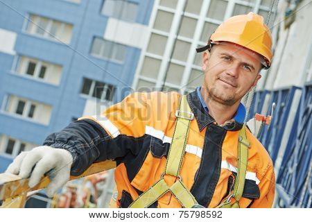 poster of worker builder making construction for ventilation facade on a building with screwdriver drill