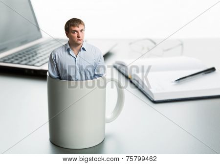 Astonished man in cup