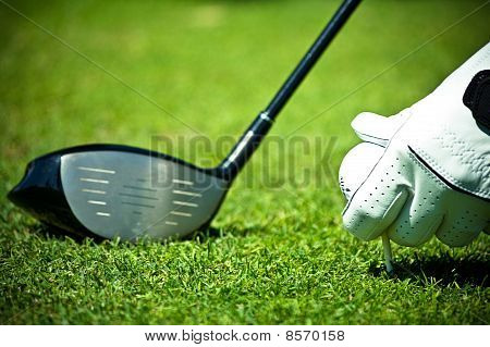 White glove, golf ball and driver