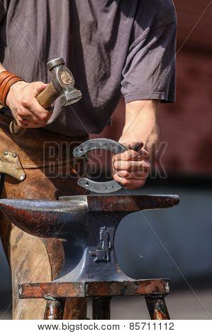 Farrier hammering