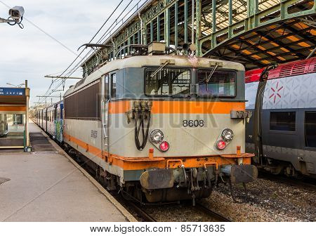 Narbonne, France - January 06: Regional Train Hauled By Electric Locomotive At Narbonne Station On J