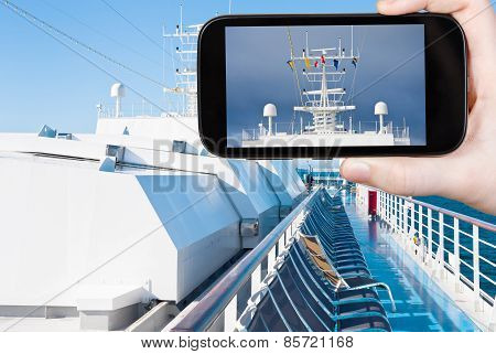 Tourist Photograph Flags On Cruise Liner
