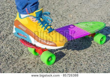 Leg Skateboarder On A Colorful Skateboard.