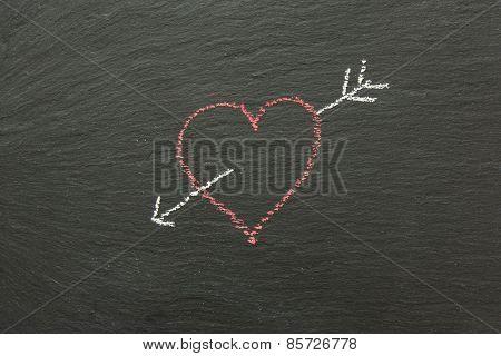 Chalk Heart With Arrow Drawn On A Chalk Board.