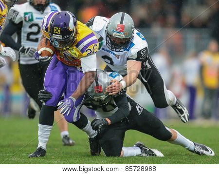 VIENNA, AUSTRIA - MARCH 23, 2014: RB Islaam Amadu (#20 Vikings) runs with the ball in an AFL football game.