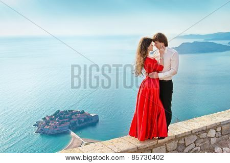 Young Couple In Love On Romantic Travel Honeymoon Vacation Summer Holidays. Fashion Girl Model In Re