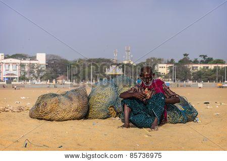 Unidentified Old Fisherman Smoking On Marina Beach