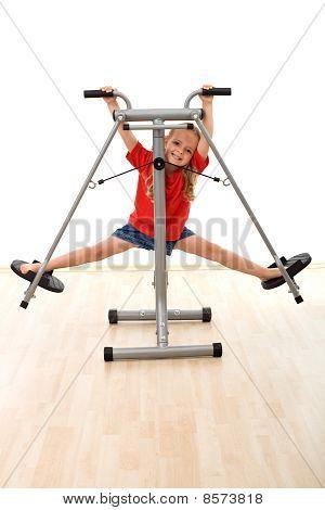 Little Girl In The Gym Having Fun
