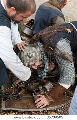 ZAGREB, CROATIA - OCTOBER 07, 2012: Squire helping injured knight at