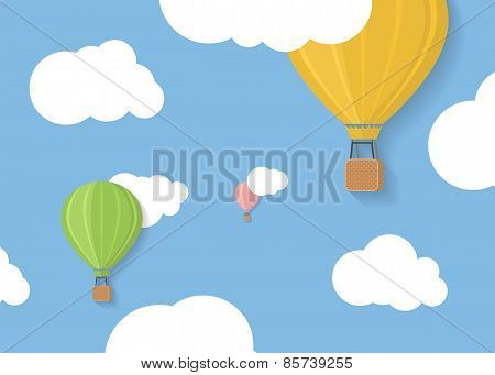 Three coloured aerostats in blue skies with clouds illustration