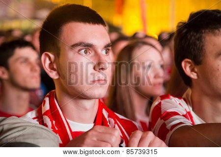 ZAGREB, CROATIA - JUNE 12, 2014: Portrait of worried young man wearing Croatian jersey at Ban Josip Jelacic square during the world cup match between Croatia and Brazil.