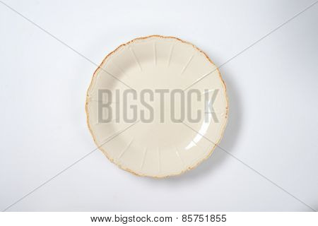 cream decorative plate on white plate