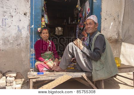 Old Woman And Man Sitting