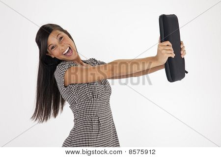Young Woman Excitedly Holding out a Laptop Case
