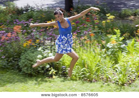 Young Woman Frolicking on Grass