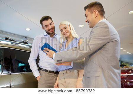 poster of auto business, car sale, technology and people concept - happy couple with car dealer in auto show or salon