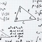 Squared sheet of paper filled with trigonometry math equations and formulas as a background composition poster