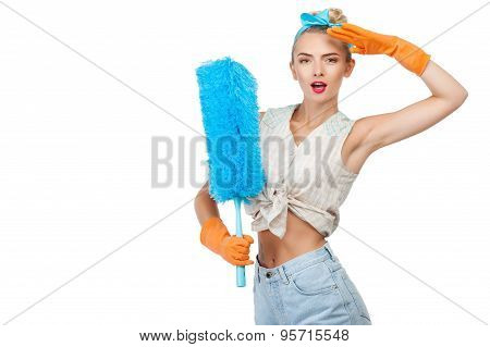 Attractive young woman is doing cleanup effectively