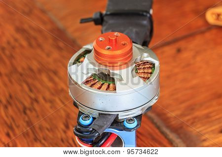 Electric motor of a small size close up poster