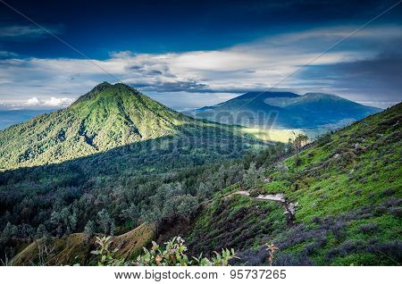 View over volcanic landscape of mountains at Kawah Ijen in morning dawn, Java, Indonesia poster
