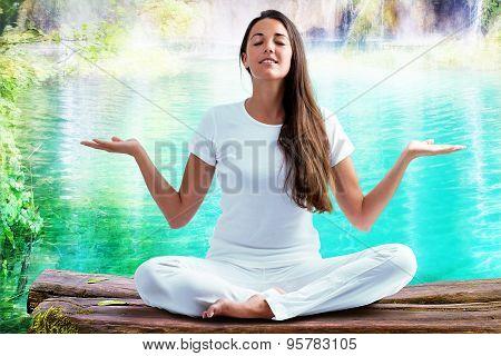 Woman Doing Yoga Exercise At Lake.