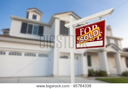 Sold Home For Sale Real Estate Sign in Front of Beautiful New House.