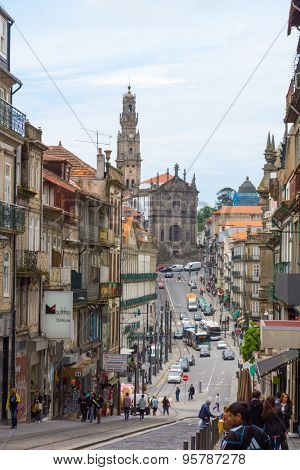 PORTO, PORTUGAL - JUNE, 12: Old town street view with Clerigos Church at day time on June 12, 2015 in Porto, Portugal