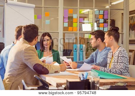 Business people speaking during a meeting at the office