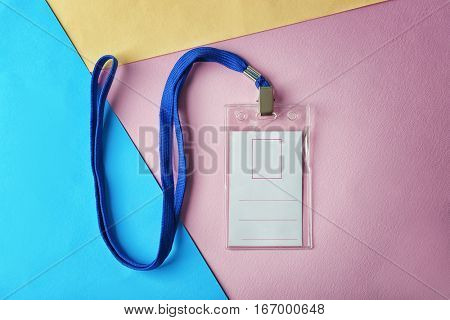 Blank badge with lanyard on color paper background