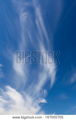 Wisp shape cirrus clouds on blue sky