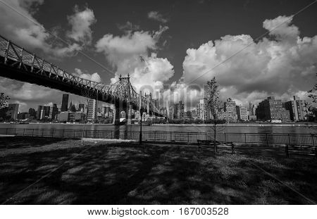 Queensboro bridge over the park, river and buildings in black and white style, New York