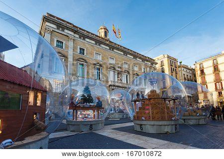 Barcelona Spain - January 02 2017: Large glass ball at the Plaza de San Jaume near the Palace of Generalitat of Catalunya