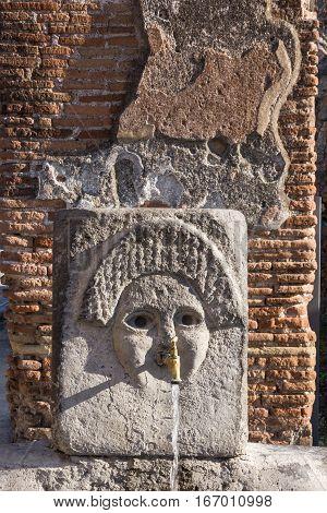 Pompeii, Naples, Italy. Ancient fontain Roman city ruins
