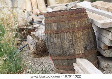 Old classic wood barrel, probably of wine. Rusty and unusable