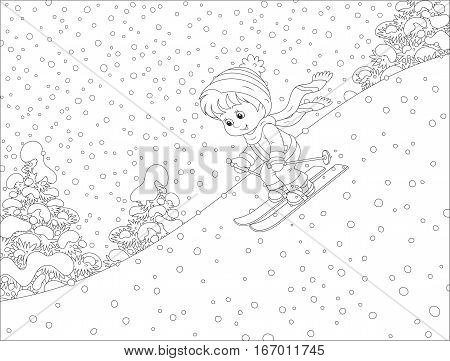 Small child skiing down the snowy hill