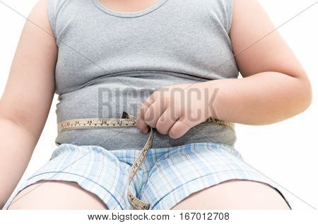 Obese Fat Boy Measuring His Belly With Measurement Tape