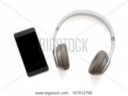 Headphones and mobile phone next to each other