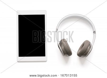 Headphones and tablet isolated on white background