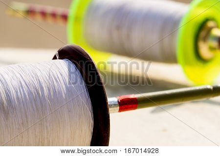 colored spool of soft thread sadda or sada for kite flying. This is popularly used in Rajasthan and Gujrat during makar sankranti and uttarayan