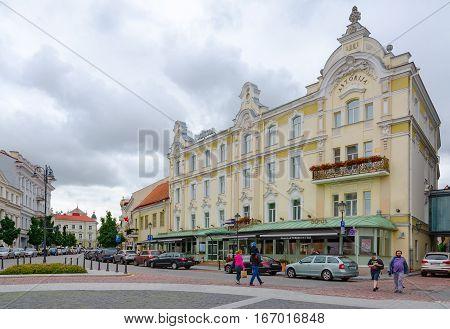 VILNIUS LITHUANIA - JULY 10 2015: Unidentified people are walking on street near Radisson Blu Royal Astorija Hotel 5 * in Old town Vilnius Lithuania