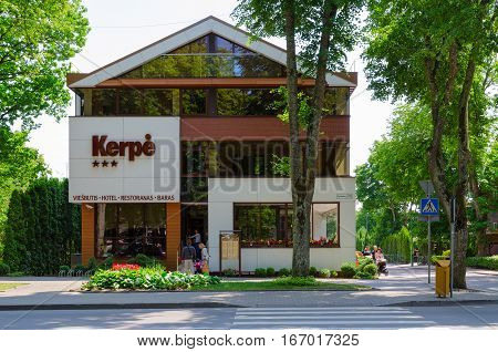 PALANGA LITHUANIA - JULY 12 2015: Unidentified people come into three-star hotel Kerpe in popular resort town of Palanga Lithuania